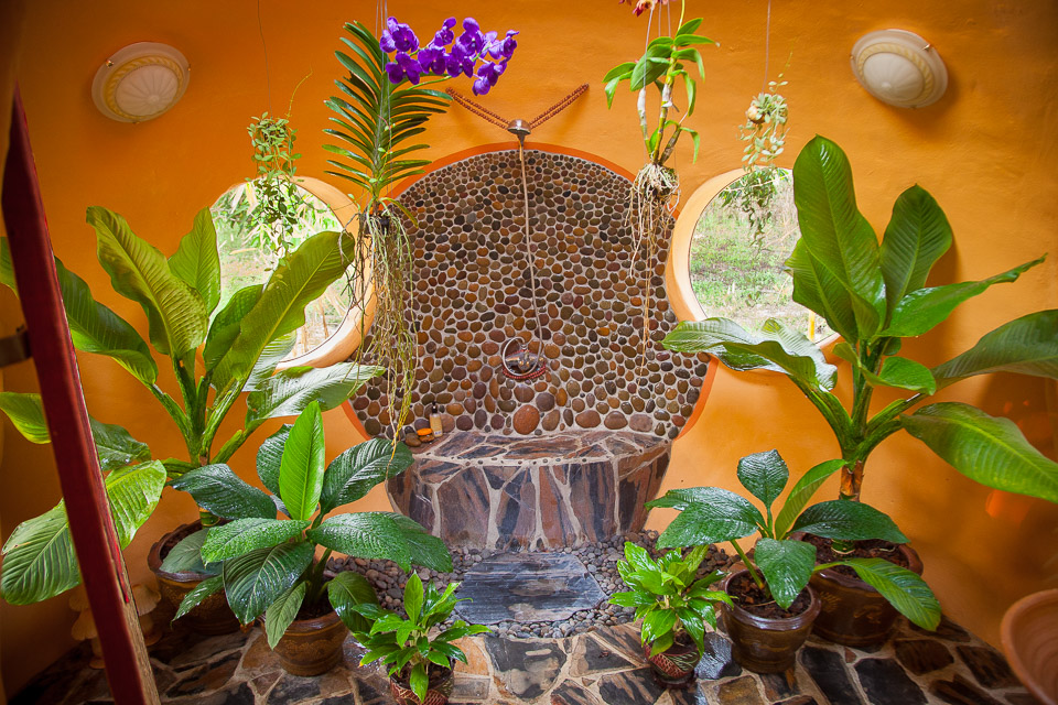 Steve's jungle bathroom!!  The round stone work in the center is my shower.